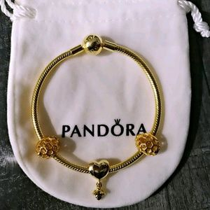 Pandora gold shine bracelet + 3 gold charms